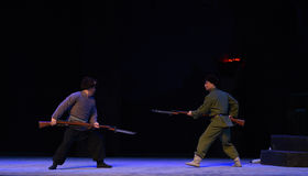 "Bajonettladdning-Peking opera som ""Taking Tiger Montain By Strategyâ € Arkivfoton"