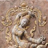 Bajorrelieve adornado en la pared del templo Fotografía de archivo libre de regalías