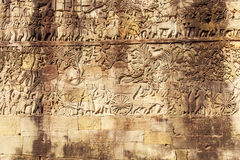 Bajorrelieve en la pared del templo de Phuon de los vagos, Angkor Thom, Siem Reap, Camboya Imagenes de archivo