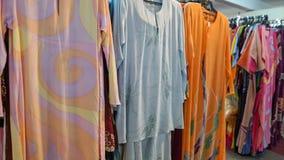Baju kurung Kaftan or caftan. Colorful hand dyed baju kurung kaftan clothing for sale Stock Images