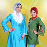 Baju Kurung. The baju kurung is a traditional Malay costume which loosely translated as enclosed dress. This type of costume is the national dress of Brunei and Stock Photo