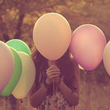 Bak ballongen Arkivbild