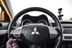 Bak hjulet av den 10th utvecklingen för bilMitsubishi lansiär Royaltyfria Foton
