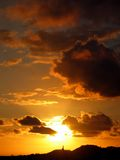 bak kyrklig solnedgång Royaltyfria Foton