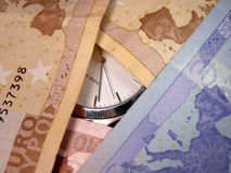 bak latent pengartid Arkivbild
