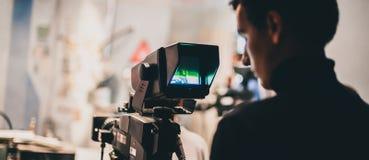bak plats Plats för kameramanskyttefilm med hans kamera Royaltyfri Bild