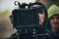 bak plats Plats för kameramanskyttefilm med hans kamera Royaltyfri Foto