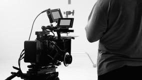 Bak videokameran, att anteckna online-reklamfilmen fotografering för bildbyråer