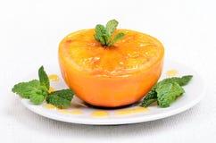 Bakad apelsin dekorerad mintkaramell Arkivfoto
