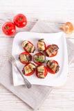 Bakad aubergine med grönsaker Fotografering för Bildbyråer
