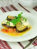 Bakad aubergine med mozzarellaen och tomater Arkivfoton