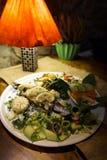 Bakad forell i en hemtrevlig restaurang i baltiska stater Lettland royaltyfri fotografi