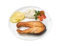 Bakad forell med grönsaker och ris Royaltyfria Foton