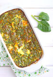 Bakad omelett med spenat Arkivfoto