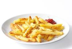 Bakad pommes frites med timjan Arkivbilder