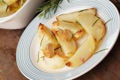 Bakad potatis med kryddan royaltyfri bild