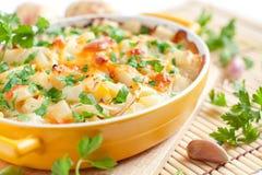 Bakad potatis med ost - smaksatt pudding royaltyfria foton
