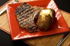 bakad potatissteak royaltyfri foto