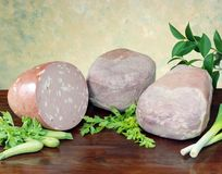 Bakad skinka och mortadella Arkivbild
