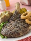 bakad steak för benpotatisribeye Royaltyfri Bild