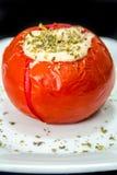 Bakad tomat som är välfylld med kasjukräm royaltyfri fotografi