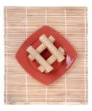 bakade bakelser plate red Royaltyfria Foton