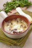 Bakade champinjoner som täckas med ost Royaltyfri Fotografi