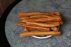 bakade churros plate nytt Royaltyfria Foton