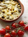 Bakade grönsaker med ost Fotografering för Bildbyråer