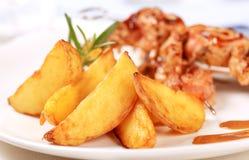 bakade potatiswedges Arkivbild
