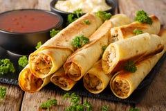 Bakade taquitos med höna- och ostnärbild horisontal Fotografering för Bildbyråer