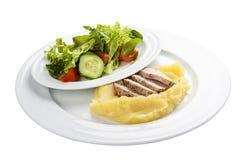 Bakat griskött med mosade potatisar royaltyfri bild