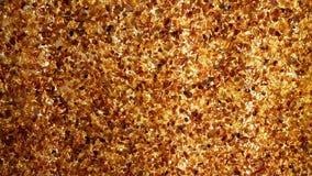 Bakbelyst bärnstensfärgad vägg arkivfilmer
