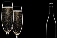 bakbelysta champagneflöjter Arkivfoton