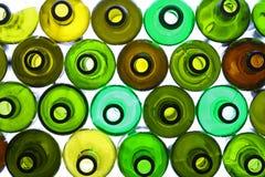 bakbelysta flaskor Arkivfoto