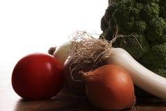 bakbelysta grönsaker Arkivfoto