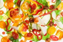 Bakbelysta skivor av peppar, gör sammandrag texturerad bakgrund Royaltyfria Bilder