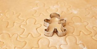 Bake Christmas gingerbread cookies, cooking in kitchen. Royalty Free Stock Photos