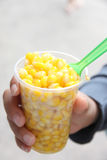 Bake corn of butter in cup. Stock Photography