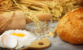 Bake fresh bread. In kitchen Royalty Free Stock Photography