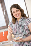 Bake - happy woman with ingredients in kitchen Royalty Free Stock Photo