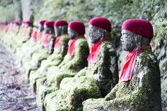 Bake Jizo. Rows of Jizo (Bodhisattva) statues along the park leading to the Kanmangafuchi Abyss.  This row is called Bake Jizo Stock Images