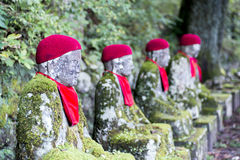 Bake Jizo. Rows of Jizo (Bodhisattva) statues along the park leading to the Kanmangafuchi Abyss.  This row is called Bake Jizo Stock Photography