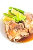 Bake pork ribs and vegetables. Closeup of bake pork ribs and vegetables isolated on the white plate Royalty Free Stock Photo