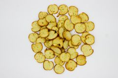 Bake Rolls. The mini bread chips isolated on white background royalty free stock photography