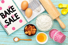 Bake sale with baking ingredients. Bake sale background with baking ingredients on wood table Stock Photography