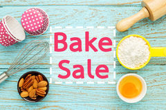 Bake sale. With baking ingredients on wood table Royalty Free Stock Photography