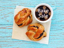 Bake sale. With bread roll and coffee cup on wood background Stock Photo