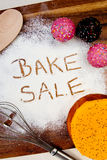 Bake Sale with cake. Written in flour Stock Photos