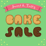 Bake sale. Inscription by cookies font. royalty free stock image
